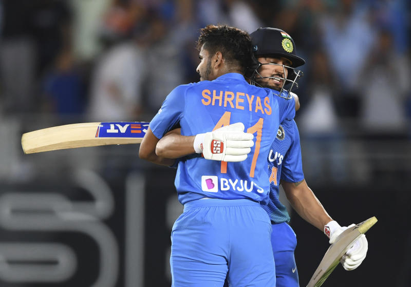 India's Manish Pandy and Shreyas Iyer celebrate during the Twenty/20 cricket international between India and New Zealand in Auckland, New Zealand, Friday, Jan. 24, 2020. (Andrew Cornaga/Photosport via AP)