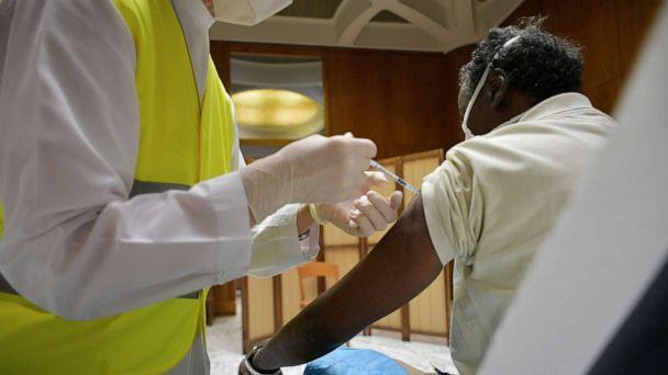 PHOTO: A person receives a dose of a vaccine against the coronavirus disease (COVID-19), at Paul VI Hall in the Vatican, March 31, 2021. (Vatican Media/Reuters)