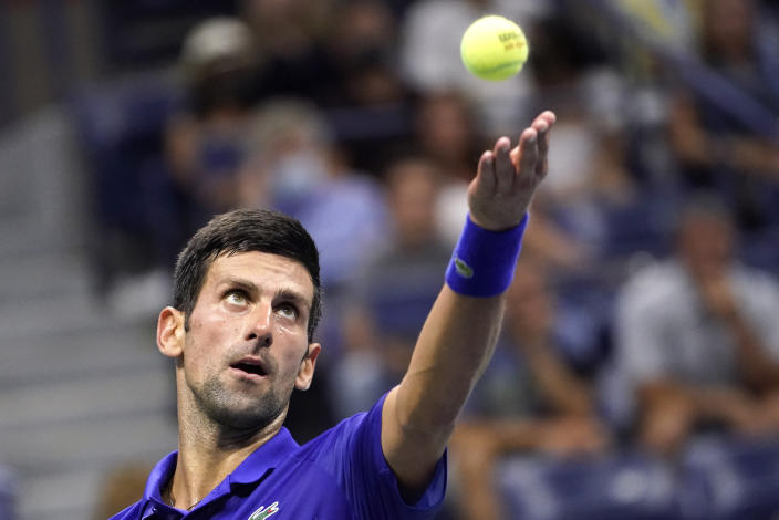 Novak Djokovic, of Serbia, serves against Jenson Brooksby, of the United States, during the fourth round of the US Open tennis championships, Monday, Sept. 6, 2021, in New York. (AP Photo/John Minchillo)