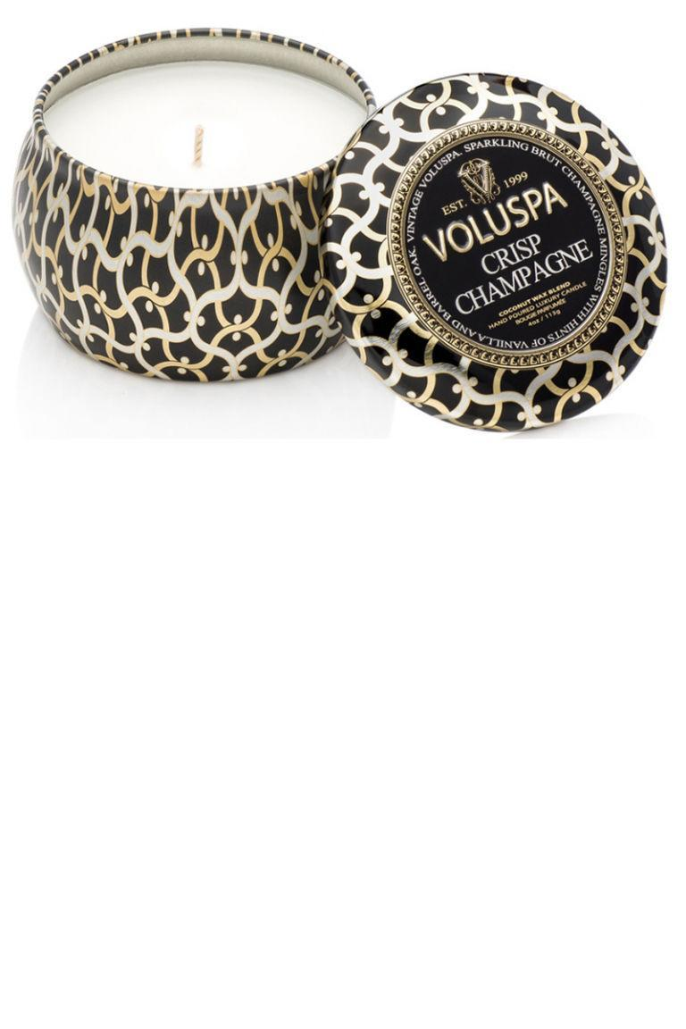"""<p>All the brightness and warmth of scents like vanilla and oak poured into a candle tin that costs way, way less than a glass of champagne. </p><p><strong>Voluspa</strong> <span>Maison Noir - Crisp Champagne Two-Wick Candle, $16, <a rel=""""nofollow noopener"""" href=""""http://shop.nordstrom.com/s/voluspa-maison-noir-crisp-champagne-two-wick-candle/3242764?cm_mmc=google-_-productads-_-Unisex%3AHome%3ACandle-_-501943&rkg_id=h-0aa80216265707709a96dcc8b28bdde0_t-1483045980&adpos=1o1&creative=39388773593&device=c&network=g&gclid=Cj0KEQiAhZPDBRCz642XqYOCpb8BEiQANUcwT77It_VdVXpgMt9_bNiqCDM4m3VZZxMOlfB9zd6_rHAaAvY68P8HAQ"""" target=""""_blank"""" data-ylk=""""slk:nordstrom.com"""" class=""""link rapid-noclick-resp"""">nordstrom.com</a>.</span></p>"""