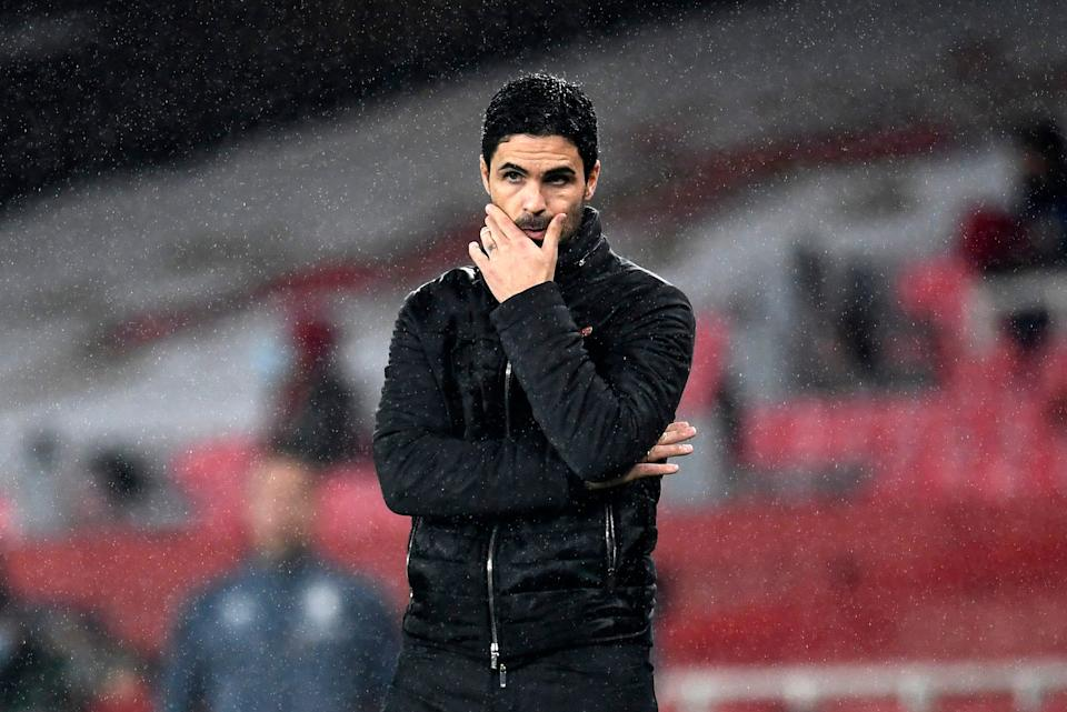 <p>Mikel Arteta watches on during Arsenal's defeat against Wolves</p>AP