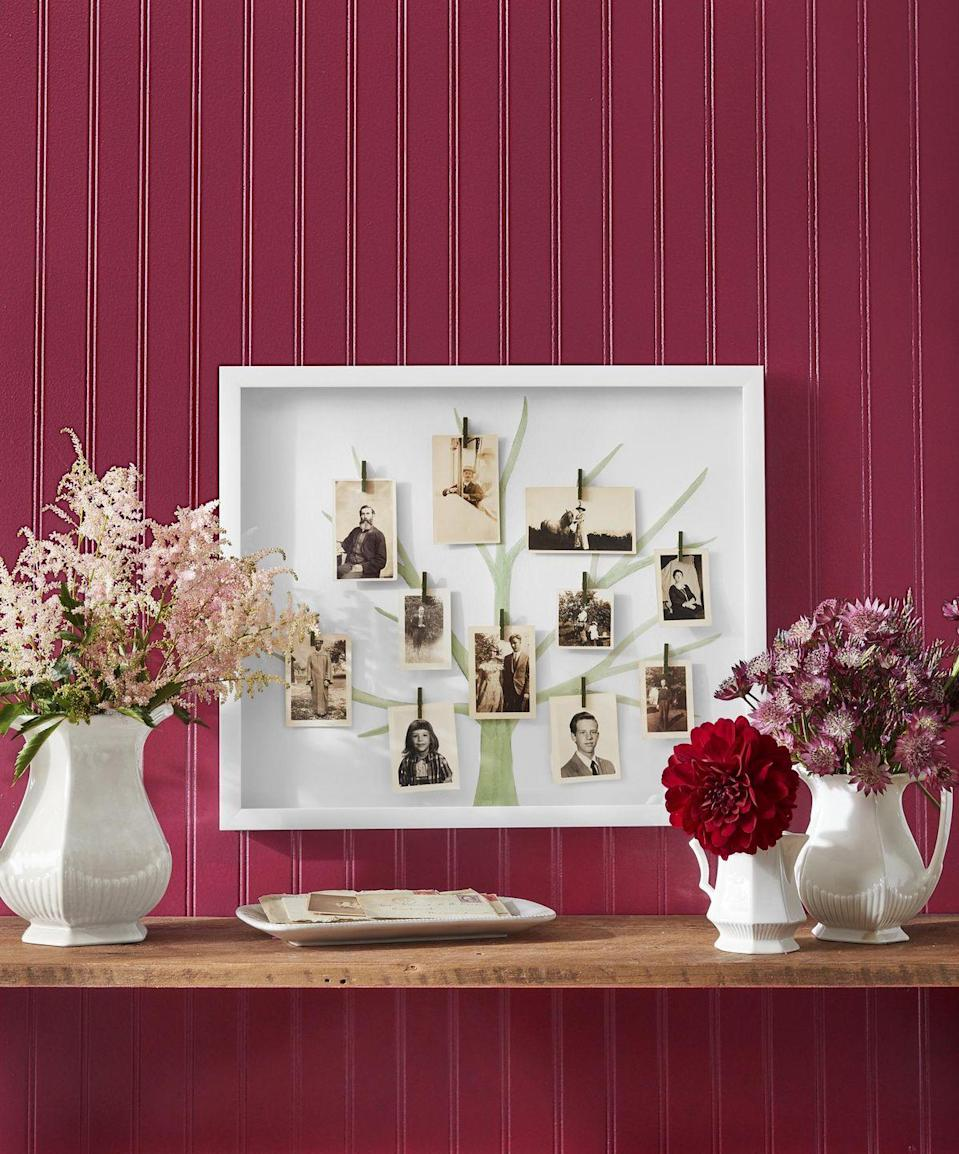"""<p>Celebrate your love ones by displaying their photos in a family tree.<br><strong><br>To make</strong>: Start by drawing a simple tree shape on a piece of watercolor paper cut to the size of a shadow box frame. Paint tree with watercolor paint. Add mini clothespins, with hot glue. Clip photos in clothespins.<br><br><a class=""""link rapid-noclick-resp"""" href=""""https://www.amazon.com/White-Shadow-Display-Case-Free-Standing/dp/B07GT663HL/ref=sr_1_1_sspa?tag=syn-yahoo-20&ascsubtag=%5Bartid%7C10050.g.23489557%5Bsrc%7Cyahoo-us"""" rel=""""nofollow noopener"""" target=""""_blank"""" data-ylk=""""slk:SHOP FRAMES"""">SHOP FRAMES</a></p>"""