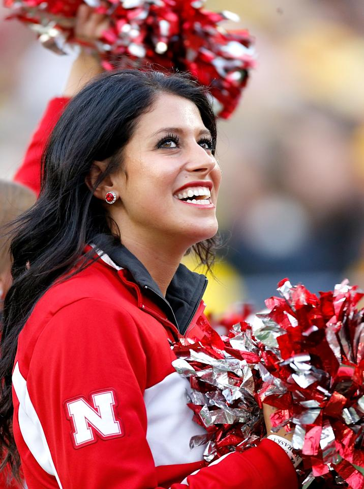 ANN ARBOR, MI - NOVEMBER 09: A cheerleader for the Nebraska Cornhuskers smiles during the first quarter against the Michigan Wolverines at Michigan Stadium on November 9, 2013 in Ann Arbor, Michigan. (Photo by Gregory Shamus/Getty Images)