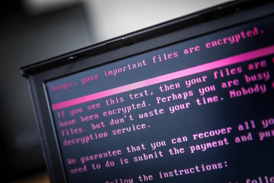 A laptop displays a message after being infected by a ransomware as part of a worldwide cyberattack on June 27, 2017 (ANP/AFP via Getty Images)