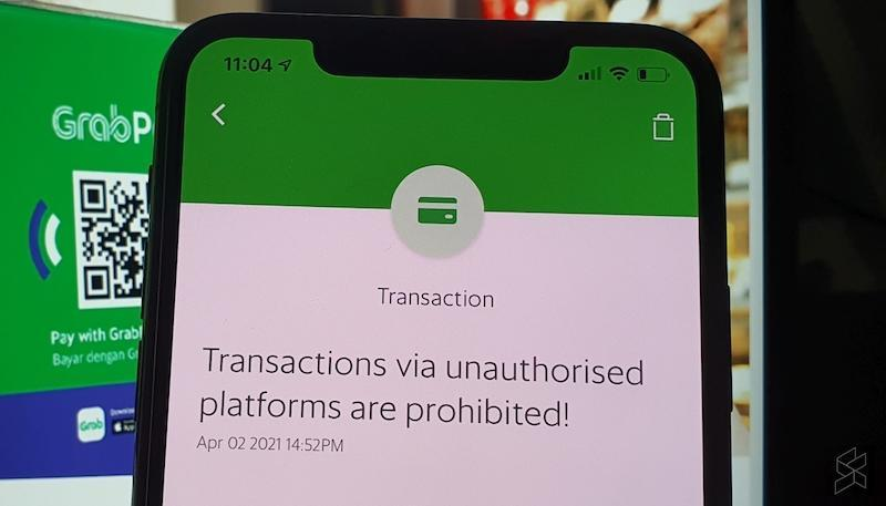 Grab has pushed out a notification to remind its users that transactions, fund transfers and purchases made via GrabPay to unauthorised or unlicensed platforms are strictly prohibited. — SoyaCincau pic
