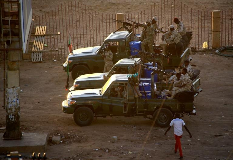 Agents of Sudan's National Intelligence and Security Service were at the forefront of a crackdown on protesters during the nationwide uprising that led to the ouster of longtime autocrat Omar al-Bashir last April (AFP Photo/ASHRAF SHAZLY)