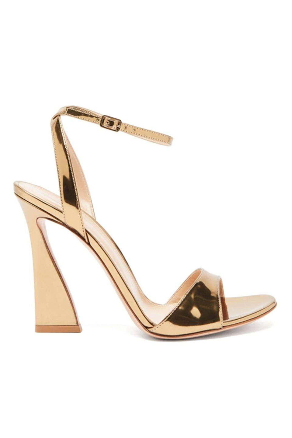 """<p><strong>Gianvito Rossi</strong></p><p>matchesfashion.com</p><p><strong>$845.00</strong></p><p><a href=""""https://go.redirectingat.com?id=74968X1596630&url=https%3A%2F%2Fwww.matchesfashion.com%2Fus%2Fproducts%2F1423629&sref=https%3A%2F%2Fwww.townandcountrymag.com%2Fstyle%2Ffashion-trends%2Fg36544376%2Fbest-metallic-accessories%2F"""" rel=""""nofollow noopener"""" target=""""_blank"""" data-ylk=""""slk:Shop Now"""" class=""""link rapid-noclick-resp"""">Shop Now</a></p><p>Hitting up the first summer party of the year? These 70s-esque stilettos will put you in a mood fit for Studio 54. </p>"""
