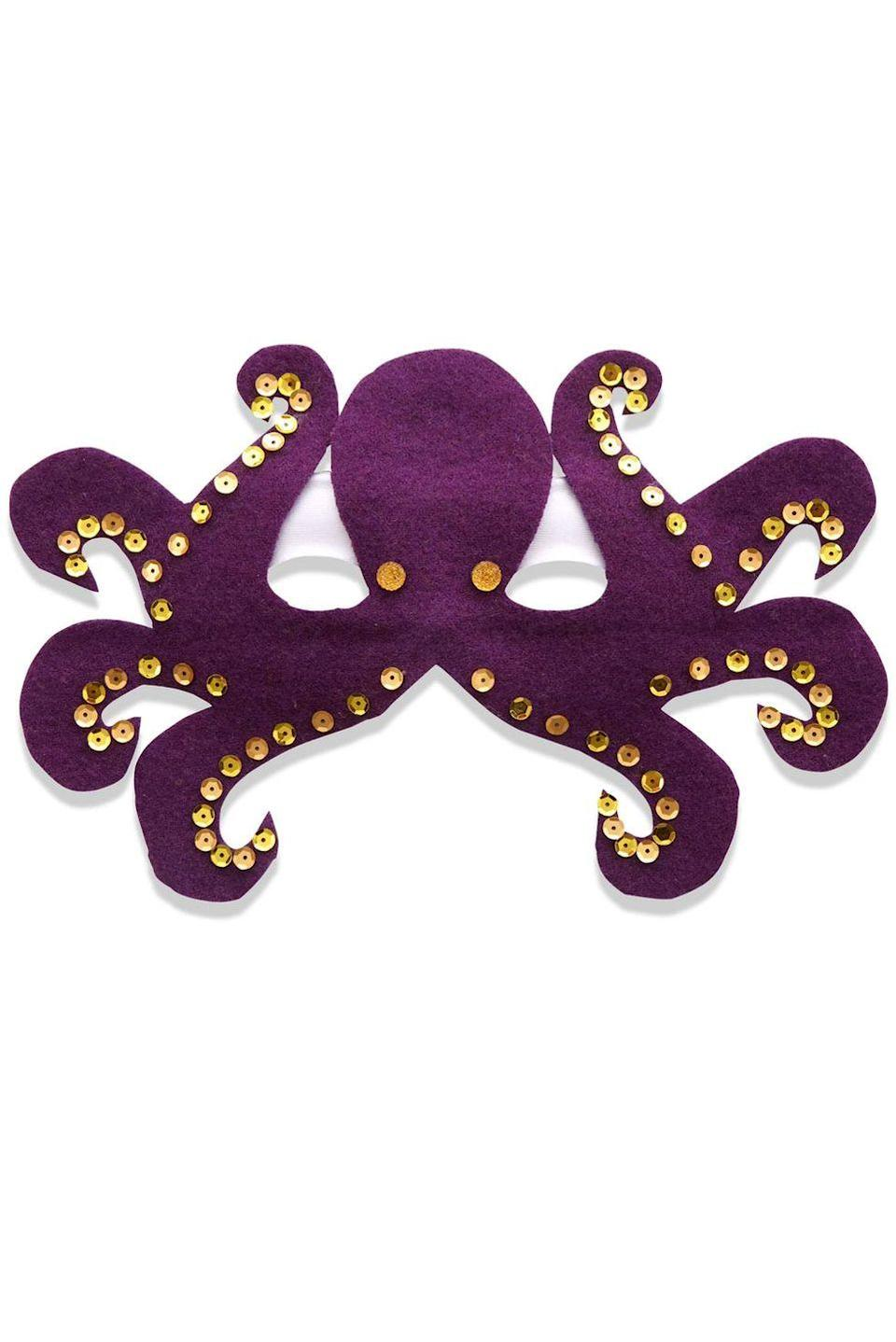 <p>Eight legs means eight times the fun on Halloween with his octopus mask. </p><p>1. Cut out the octopus shape from purple felt and use craft glue to affix it to the mask, lining up the bottom of each eye with the top of the first tentacle. Let dry. </p><p>2. Glue on rhinestones for eyes and sequins along the bottom of each tentacle to create suction cups. </p><p>3. To complete this look, using double-stick fabric tape, attach gold cupcake liners to a long-sleeve purple T-shirt to create two more tentacles.</p>