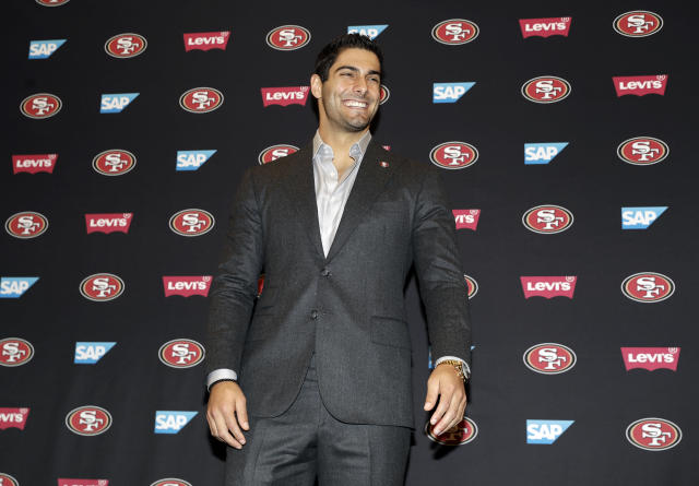San Francisco 49ers quarterback Jimmy Garoppolo smiles as he poses for photographs after an NFL football press conference Friday, Feb. 9, 2018, in Santa Clara, Calif. Garoppolo has signed a five-year contract with the 49ers worth a record-breaking $137.5 million. (AP Photo/Marcio Jose Sanchez)