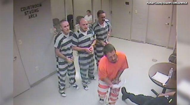 A group of at least eight inmates noticed a lone guard slumped in his chair, so they broke from their cell to get help. Source: Parker County Sheriff's Office