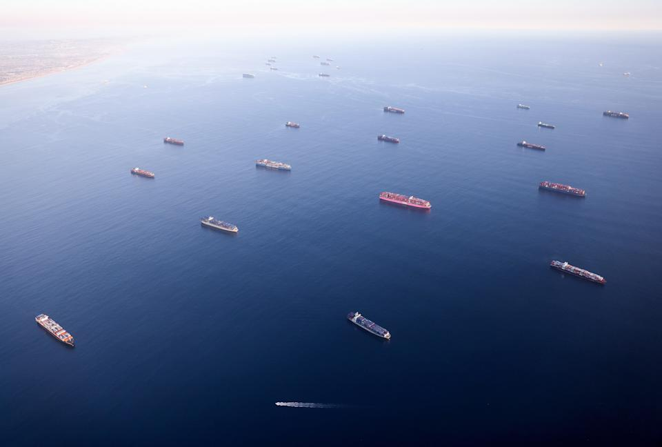 In an aerial view, container ships are anchored by the ports of Long Beach and Los Angeles as they wait to offload on Sept. 20, 2021, near Los Angeles.