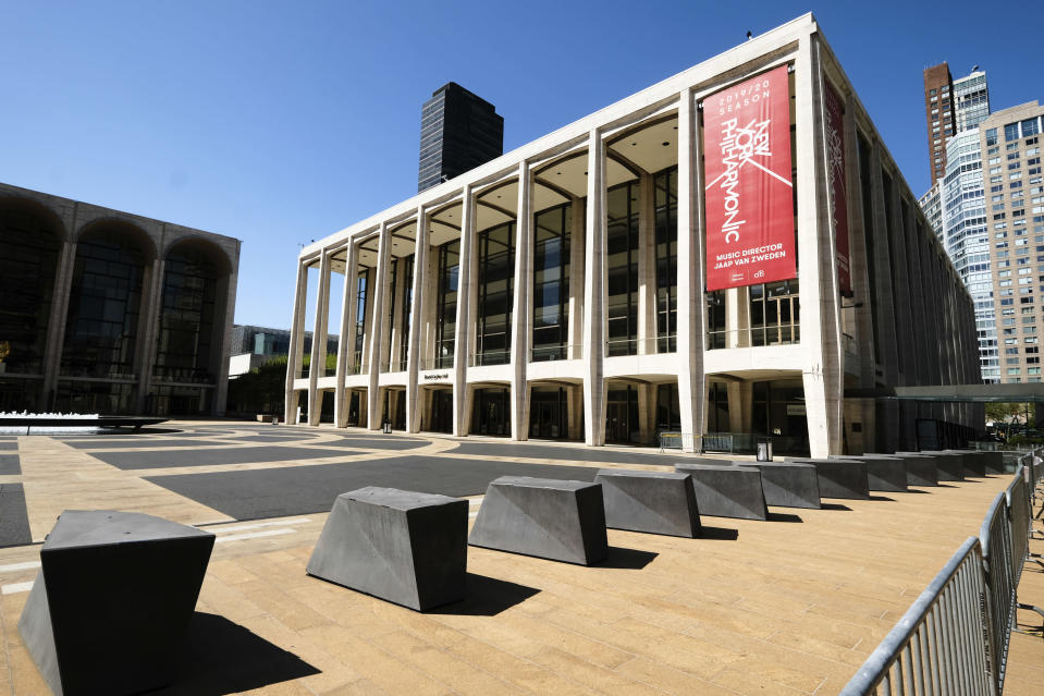 FILE - This May 12, 2020 file photo shows David Geffen Hall at Lincoln Center, closed during COVID-19 lockdown, in New York. The New York Philharmonic canceled its fall season because of the coronavirus pandemic. (Photo by Evan Agostini/Invision/AP, File)