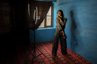 """A transgender Kashmiri Manu Babo makes an instagram video at home in Srinagar, Indian controlled Kashmir, Wednesday, June 9, 2021. Babo is a 19-year-old self-taught make-up artist living who is bending the rules of conservative Kashmiri society. Her instagram account reads """"A Proud Transgender"""". She received assignments even during the pandemic from her instagram and YouTube accounts. (AP Photo/ Dar Yasin)"""