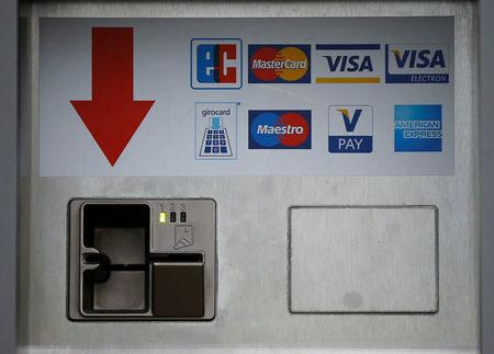 FILE PHOTO: A card slot for various credit and payment cards (Eurocheque, Mastercard, Visa, Visa Electron, girocard Maestro, V-Pay and American Express) is pictured in Duesseldorf, Germany, April 7, 2016.   REUTERS/Wolfgang Rattay/File Photo