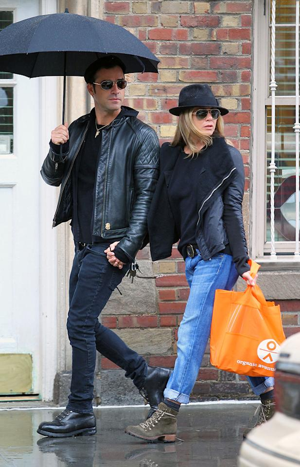 """Hot couple du jour Jennifer Aniston and Justin Theroux braved the rain to hit up upscale kitchen supply shop Sur La Table in Manhattan on Tuesday. According to reports, the duo purchased more than $130 worth of loot including napkins, a bread pan, and glassware. When you're shopping for housewares together, you know it's serious! Jay Thornton/<a href=""""http://www.infdaily.com"""" target=""""new"""">INFDaily.com</a> - September 20, 2011"""