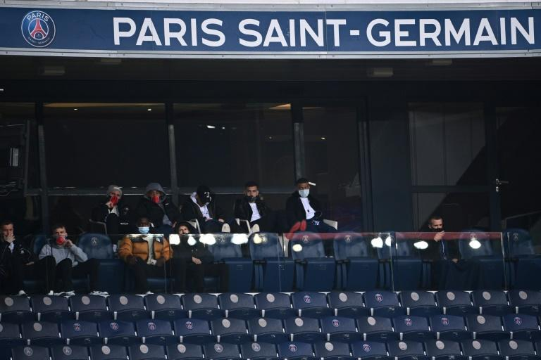Kylian Mbappe sat next to team-mate Leandro Paredes in the stand as PSG beat Lens