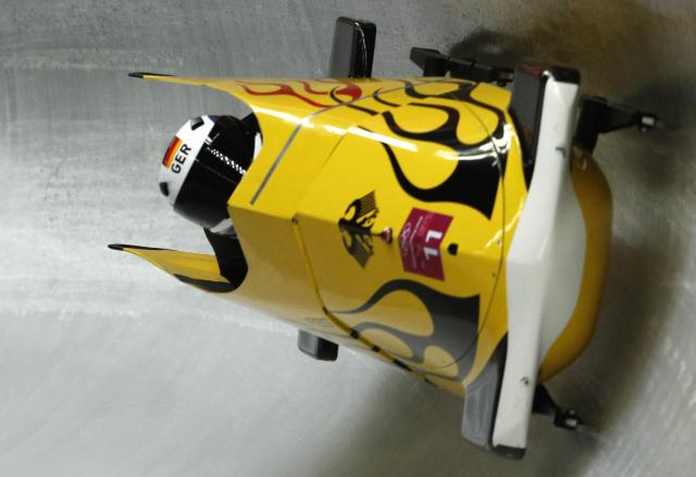 Nico Walther and Christian Poser crashed across the finish line on Sunday to take gold medal position in the second of four bobsled runs. (Reuters)