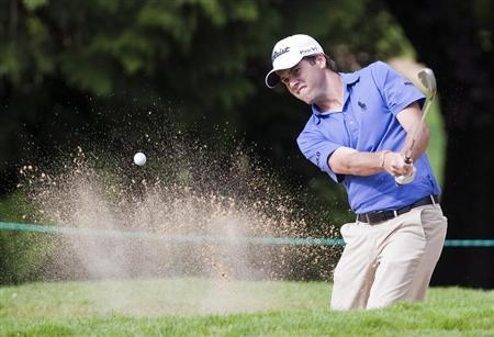 Ben Martin of the U.S hits out of the bunker on the 7th hole during the Canadian Open golf in Vancouver.