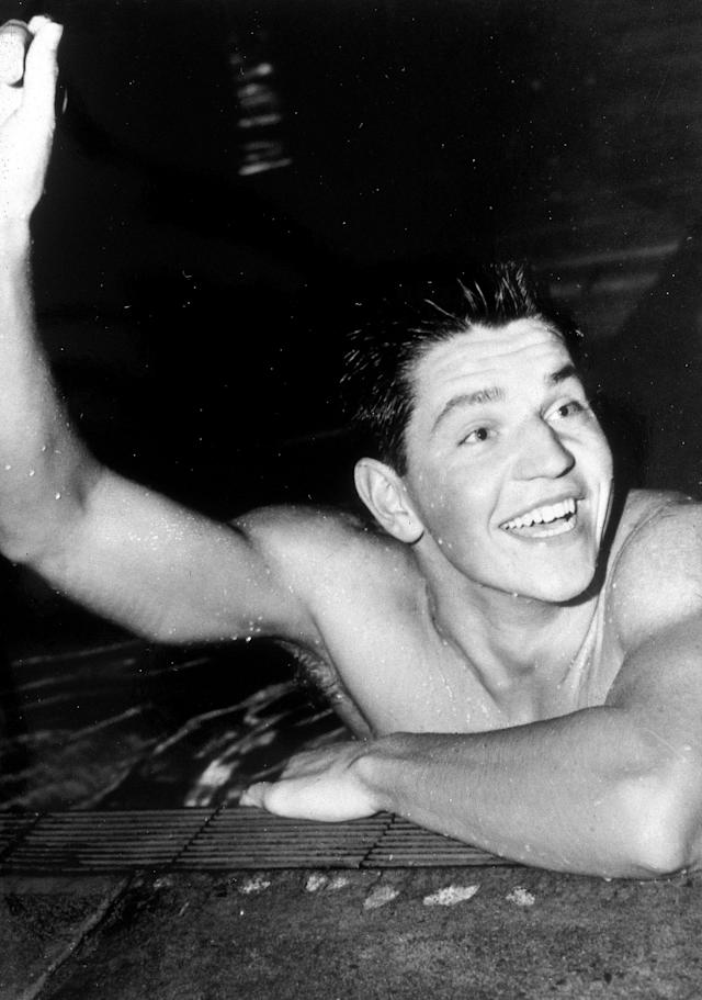 ROME, ITALY - 1960: John Konrads of Australia celebrates after winning the mens 1500m freestyle during the 1960 Rome Olympics held in Rome, Italy. Konrads was an Australian swimmer of the 1950s and 1960s, who won the 1500 m freestyle at the 1960 Summer Olympics in Rome. In his career, he set 26 individual world records. (Photo by Getty Images)
