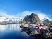 """<p>This fishing village sits above the Arctic Circle in Norway's Lofoten Islands and has a population of about 300. Just imagine the <a href=""""https://www.purewow.com/travel/where-to-see-northern-lights"""" rel=""""nofollow noopener"""" target=""""_blank"""" data-ylk=""""slk:northern lights"""" class=""""link rapid-noclick-resp"""">northern lights</a> from here.</p>"""