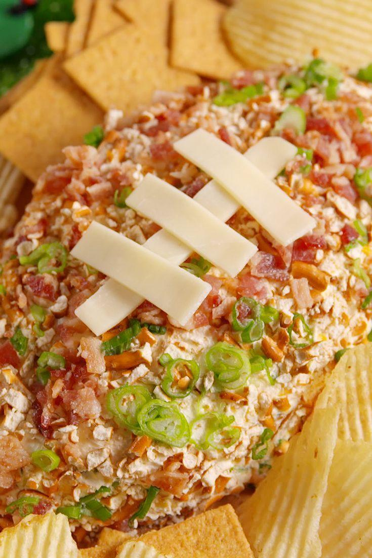 """<p>Be the MVP of your Superbowl party.</p><p>Get the recipe from <a href=""""https://www.delish.com/cooking/recipe-ideas/recipes/a51153/football-cheeseball-recipe/"""" rel=""""nofollow noopener"""" target=""""_blank"""" data-ylk=""""slk:Delish"""" class=""""link rapid-noclick-resp"""">Delish</a>.</p>"""