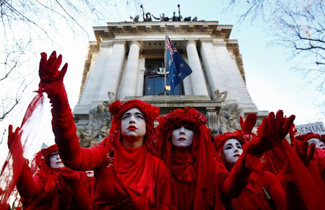 'Red Brigade' activists demonstrate against the Australian government's inaction over climate change despite the bushfires crisis, outside the Australian Embassy in London, UK. Photo: Henry Nicholls/Reuters