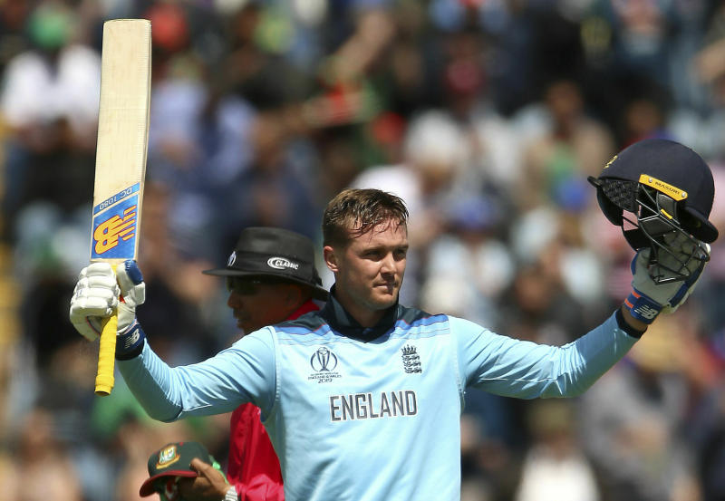 England's Jason Roy celebrates hitting a century  during the ICC Cricket World Cup group stage match between England and Bangladesh at the Cardiff Wales Stadium, Wales, Saturday, June 8, 2019. (Nigel French/PA via AP)