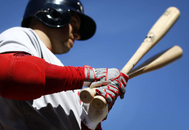 Boston Red Sox' Daniel Nava warms up before an at-bat in the first inning of an opening day baseball game against the Baltimore Orioles, Monday, March 31, 2014, in Baltimore. (AP Photo/Patrick Semansky)