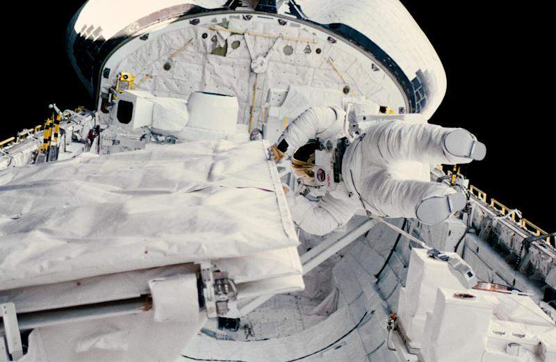 Astronaut Kathryn D. Sullivan checks the latch of the SIR-B antenna in the space shuttle Challenger's open cargo bay during her historic extravehicular activity (EVA) on Oct. 11, 1984. (NASA)