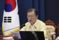 South Korean President Moon jae-in speaks during a Cabinet meeting at the presidential Blue House in Seoul, South Korea, Tuesday, Sept. 28, 2021. After the North Korea's launch Tuesday, Moon ordered officials to examine its latest weapons firing and previous outreach in a comprehensive manner before formulating countermeasures, according to Moon's office. (Choe Jae-koo /Yonhap via AP)