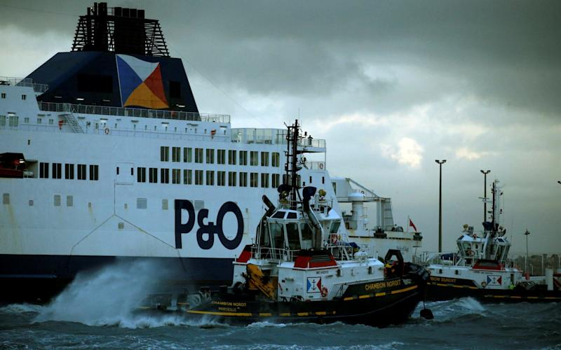 A tugboat manoeuvres the P&O ferry Pride of Kent after it ran aground during bad weather in the port of Calais - REUTERS
