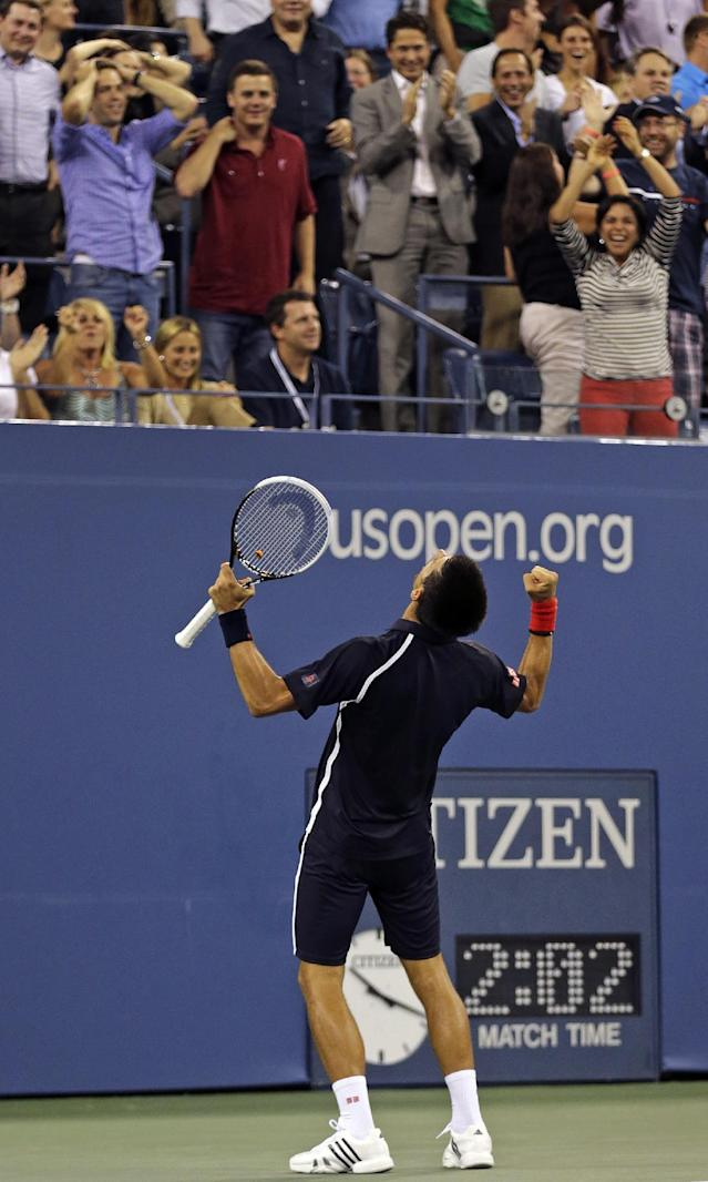 Novak Djokovic, of Serbia, cheers with the crowd during the second set against Juan Martin del Potro, of Argentina, in the quarterfinal round of play at the U.S. Open tennis tournament, Thursday, Sept. 6, 2012, in New York. (AP Photo/Charles Krupa)