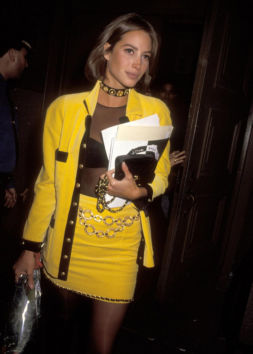 <p>Turlington wears matching yellow with a choker for a City Kids Foundation Benefit</p>