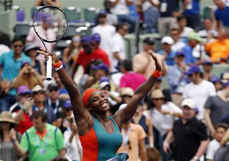 Mar 29, 2014; Miami, FL, USA; Serena Williams celebrates after her match against Li Na (not pictured) during the women's final of the Sony Open at Crandon Tennis Center. Williams won 7-5, 6-1. Mandatory Credit: Geoff Burke-USA TODAY Sports