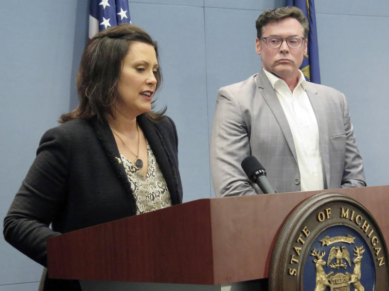 Michigan Gov. Gretchen Whitmer speaks about the approval of state incentives for Fiat Chrysler's expansion in the state during a news conference, Tuesday, May 21, 2019, at her office in Lansing, Mich. Standing next to her is Mark Stewart, FCA North America's chief operating officer. (AP Photo/David Eggert)