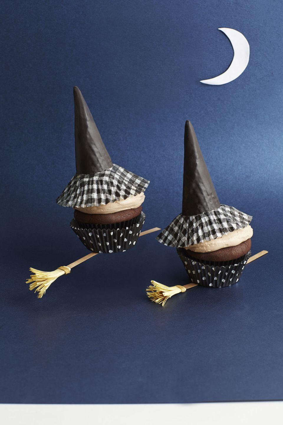 """<p>This chocolate and pumpkin cupcake is only enhanced by the magical witches hat and broom that let you know you're in for a mystical night. </p><p><a href=""""https://www.womansday.com/food-recipes/food-drinks/recipes/a40351/chocolate-pumpkin-witch-cupcakes-recipe-clx1014/"""" rel=""""nofollow noopener"""" target=""""_blank"""" data-ylk=""""slk:Get the Chocolate Pumpkin Witch Cupcakes recipe."""" class=""""link rapid-noclick-resp""""><em>Get the Chocolate Pumpkin Witch Cupcakes recipe.</em></a> </p>"""
