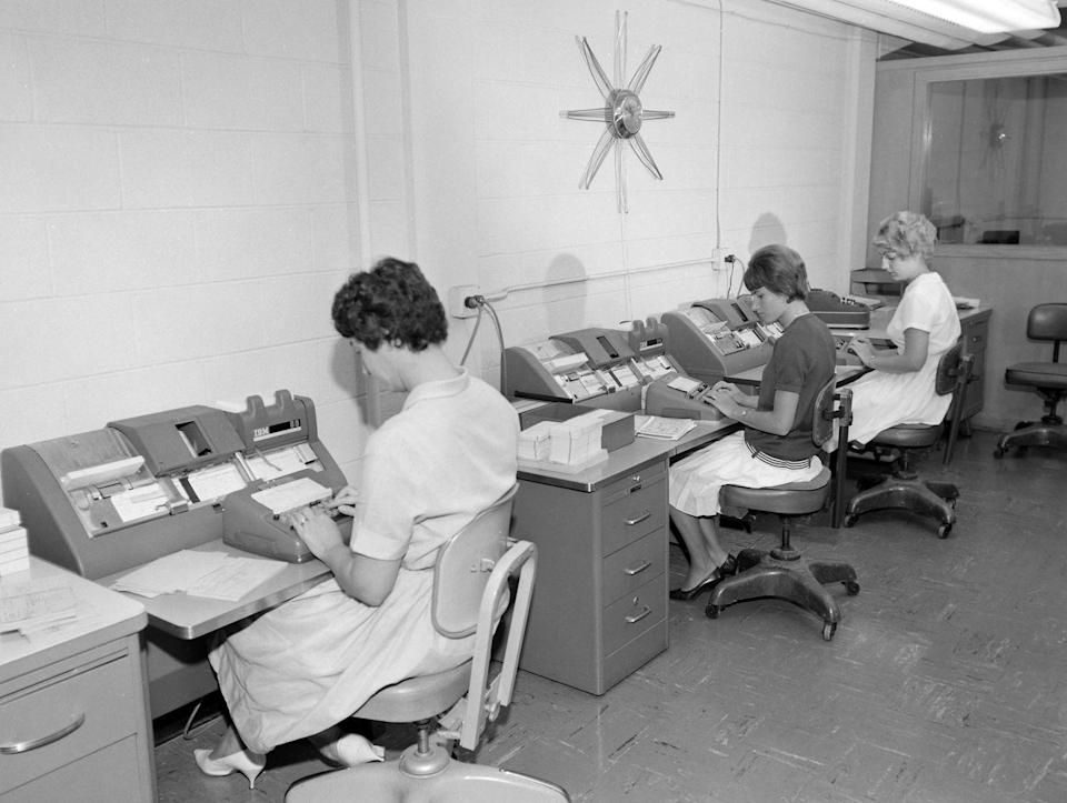 <p>In this Chicago office, three employees work on IBM data processing machines, one of the first mass produced computers in the world. These machines were marketed for more general business purposes, and the advancement of technology from this point forward had a powerful impact on how companies conducted business. </p>