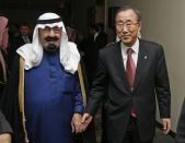 Saudi Arabia's King Abdullah bin Abdulaziz (L) hold hands with U.N. Secretary General Ban Ki-moon during a dinner prior to the start of the General Assembly Meeting of the Culture of Peace, at United Nations Headquarters, in New York in this November 11, 2008 file photo. REUTERS/UN Photo/Evan Schneider/Handout/Files