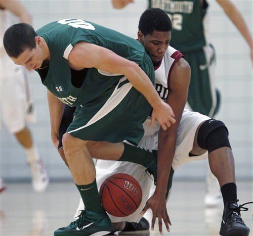 Harvard forward Keith Wright, right, tries to get a grip on a loose ball as Dartmouth guard John Golden, left, tries to regain possession in the first half during an NCAA college basketball game in Cambridge, Mass., Saturday Jan. 7, 2012. (AP Photo/Charles Krupa)