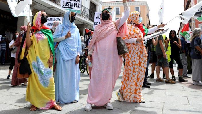 Four women taking part in a Saharawi freedom march in Madrid, Spain - Friday 18 June 2021