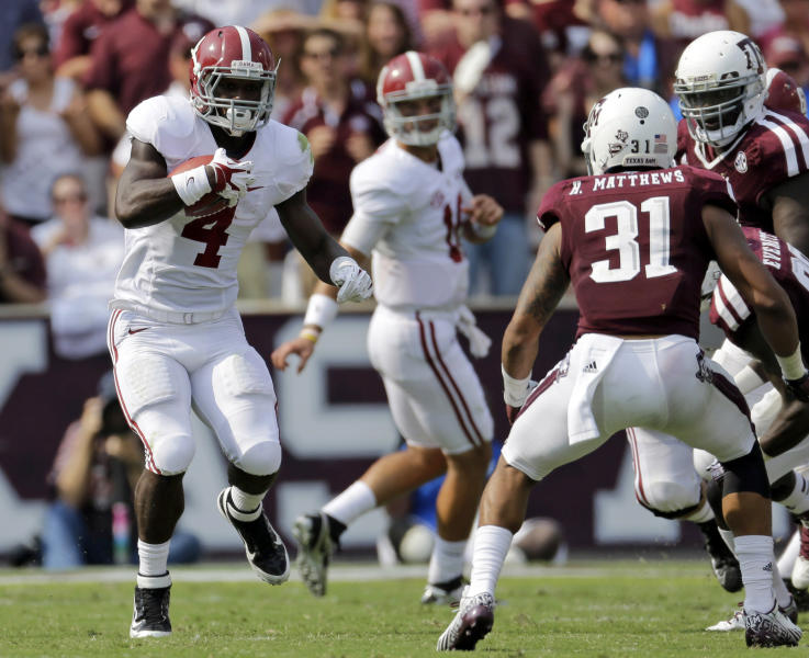 FILE - In this Sept. 14, 2013, file photo, Alabama running back T.J. Yeldon (4) rushes for a gain against Texas A&M during the second quarter of an NCAA college football game in College Station, Texas. While Yeldon has had nifty runs and decent numbers, the top-ranked Crimson Tide's ground game ranks last in the Southeastern Conference and the offense is only one spot higher in total yards. (AP Photo/David J. Phillip, File)