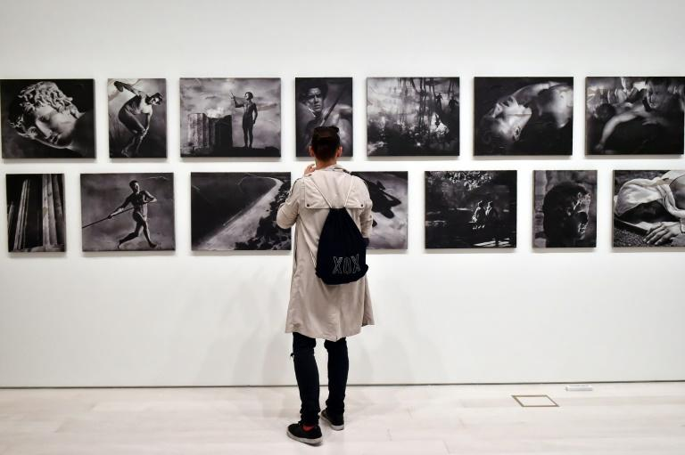 """A visitor admires """"The Greek way"""", by Polish-US artist Piotr Uklanski and US artists McDermott & McGough ahead of the public opening of the Documenta 14 art exhibition in Athens"""