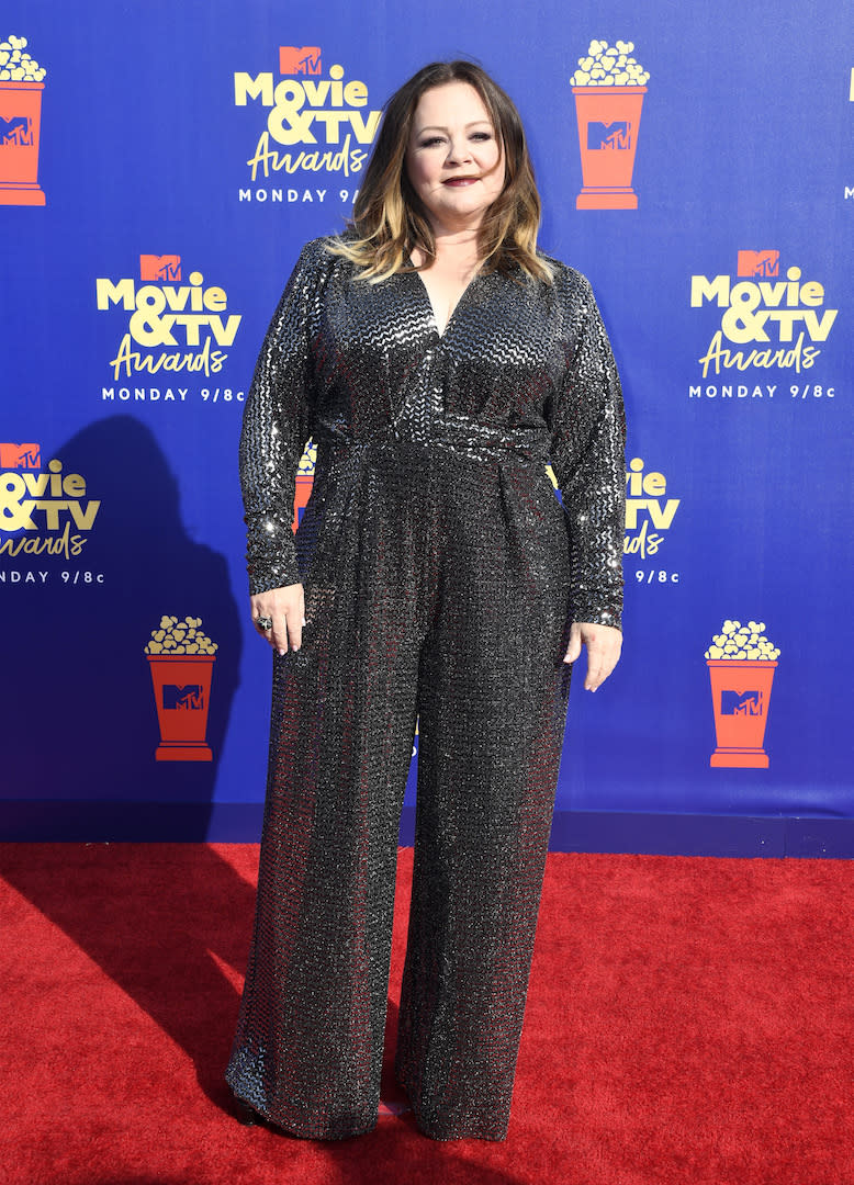 For the starry ceremony, Melissa McCarthy opted for a glitzy jumpsuit by Talbot Runhof finished with a vampy lip. <em>[Photo: Getty]</em>