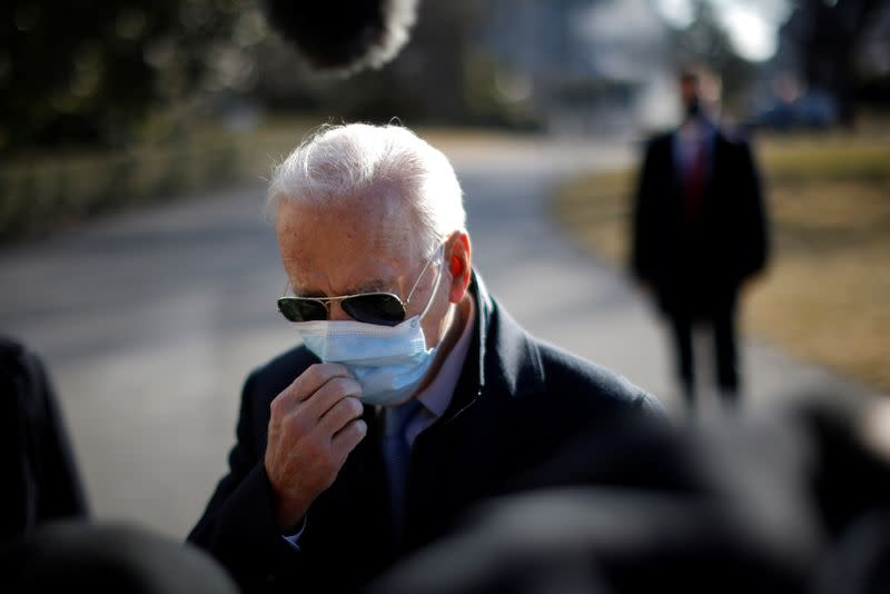 Biden reacts as he arrives on South Lawn at White House in Washington