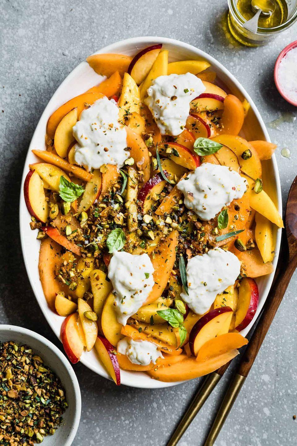 """<p>Proof that you don't need lettuce to create a delicious and relatively healthy vegetarian side dish. </p><p><a href=""""https://www.snixykitchen.com/summer-fruit-salad-with-herbed-pistachio-crumble/"""" rel=""""nofollow noopener"""" target=""""_blank"""" data-ylk=""""slk:Get the recipe."""" class=""""link rapid-noclick-resp"""">Get the recipe. </a></p>"""