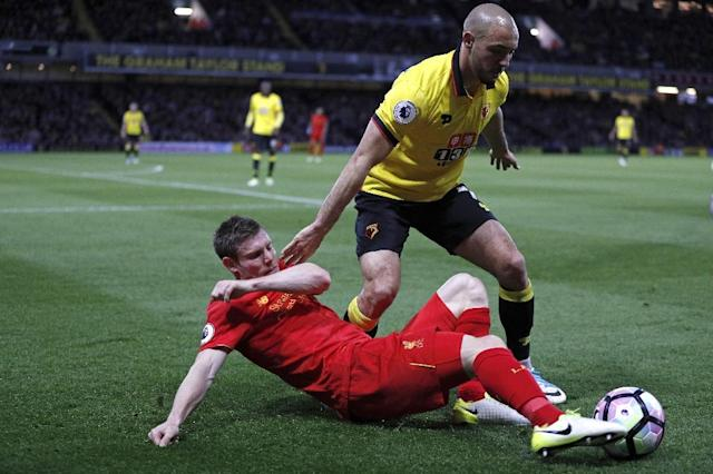 Watford's midfielder Nordin Amrabat vies with Liverpool's midfielder James Milner (L) during the English Premier League football match between Watford and Liverpool at Vicarage Road Stadium in Watford, north of London on May 1, 2017 (AFP Photo/Adrian DENNIS)