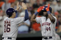 Houston Astros' Yordan Alvarez (44) is greeted at home by Aledmys Diaz (16) after Alvarez hit a grand slam off Baltimore Orioles relief pitcher Tayler Scott during the seventh inning of a baseball game Saturday, Aug. 10, 2019, in Baltimore. (AP Photo/Julio Cortez)