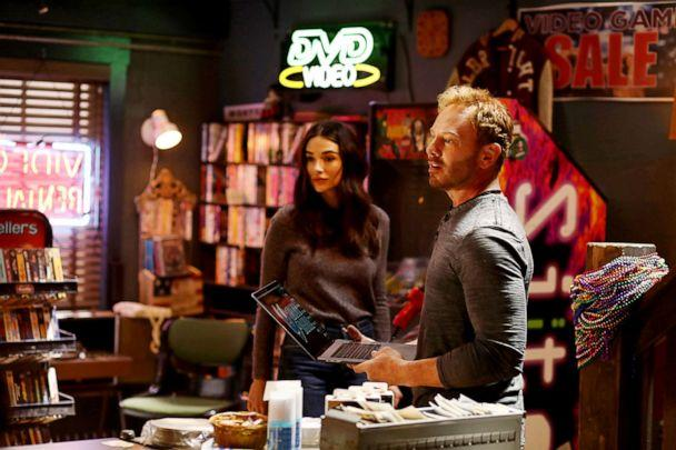 PHOTO: Ian Ziering appears with actress Crystal Reed in a scene from 'Swamp Thing.' (The CW Network)