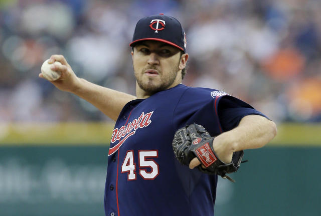 Minnesota Twins starting pitcher Phil Hughes throws during the first inning of a baseball game against the Detroit Tigers in Detroit, Friday, May 9, 2014. (AP Photo/Carlos Osorio)