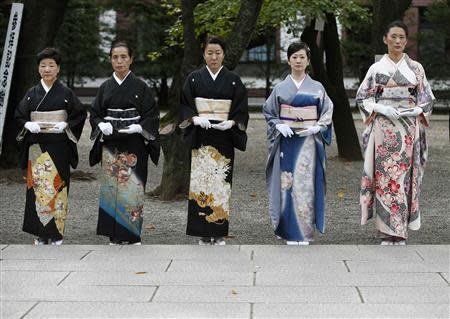 Women in kimonos stand at the Yasukuni Shrine during the Annual Autumn Festival in Tokyo